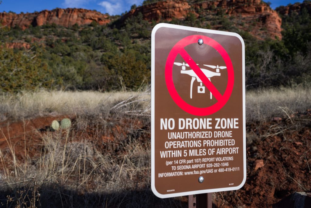 FPV Flying Spot No Drone Zone Red Sign Mountains in Background